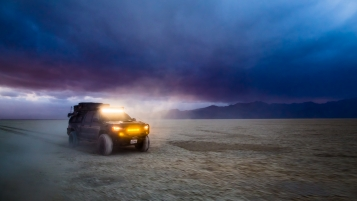 Toyota Tacoma racing offroad on the playa